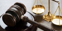 Gavel and scales of justice on table.