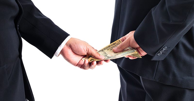 receiving money behind his back concept for corruption