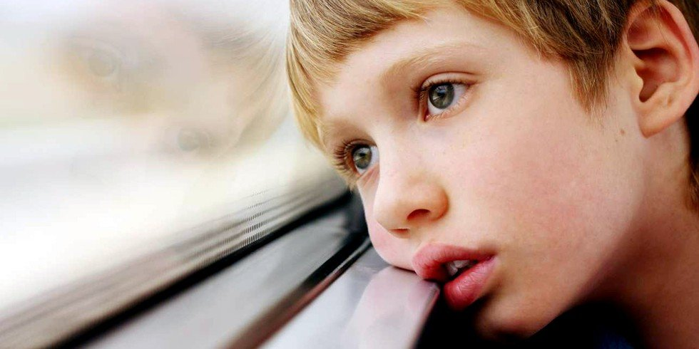 Boy with Austism gazing out window