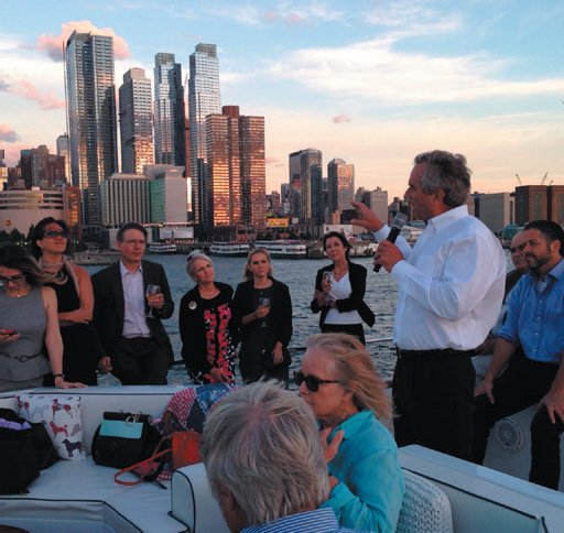 HUDSON RIVER HERO—Following the United Nations screening of Trace Amounts, Mr. Kennedy explains to guests how Riverkeeper helped restore the health of the Hudson River.