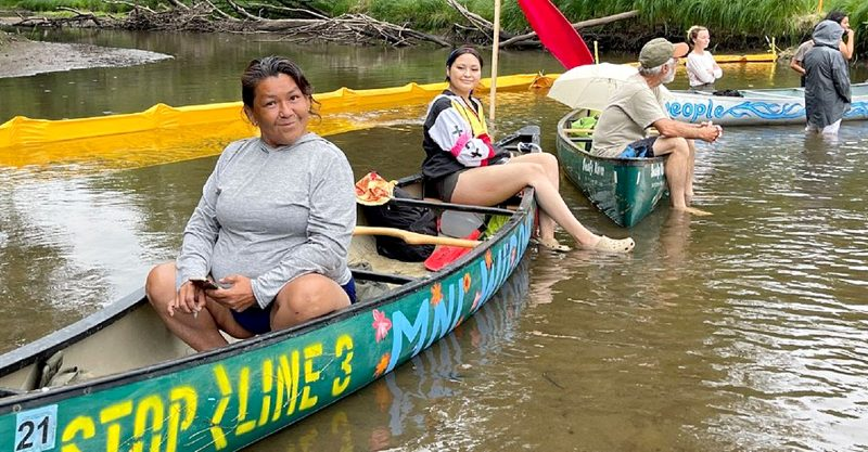 """Water protectors in the area of Willow River where Enbridge is working to install a """"climate-wrecking"""" tar sands pipeline."""