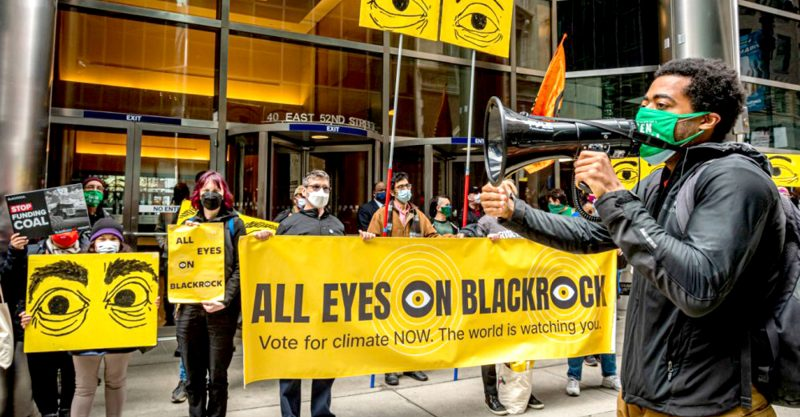 Climate campaigners denounced financial investment giants BlackRock and Vanguard.