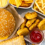 As Americans devour a fast-food burger in the car or gobble up a chicken burrito in front of the TV, some may bite into phthalates.
